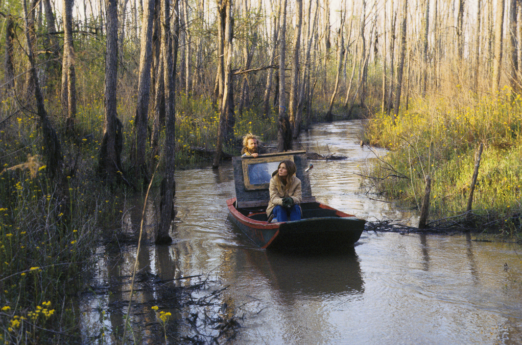 Calvin and Gwen in in their cypress bateau on small slew off Jake's Bayou