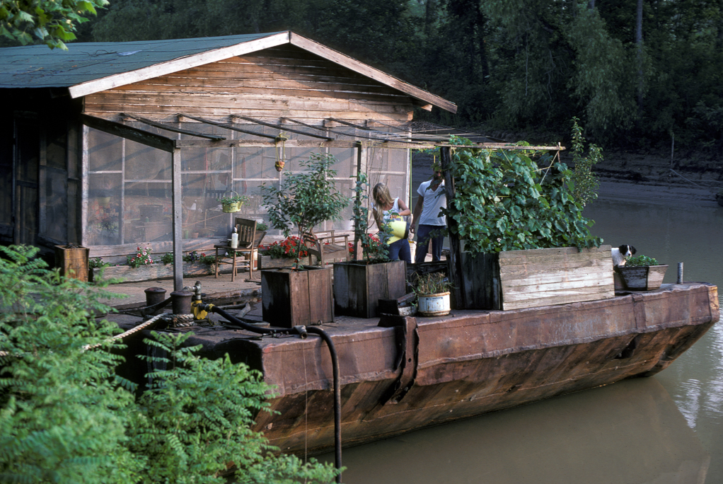 Calvin Voisin and Gwen Carpenter's houseboat on a barge in the Atchafalaya Basin.